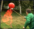 Pete blows up a balloon